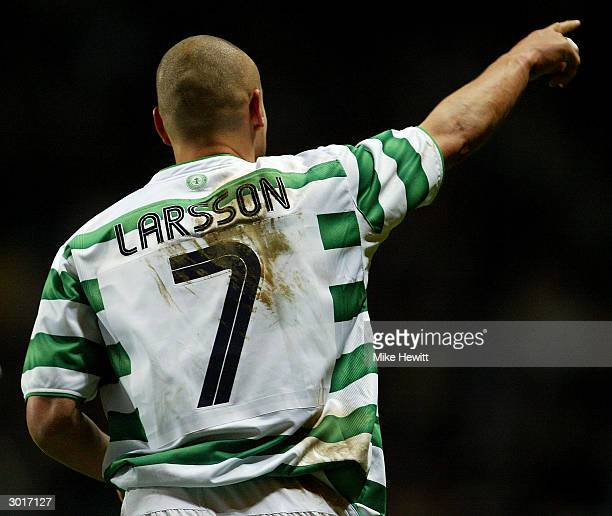 Henrik Larsson of Celtic salutes the crowd after scoring his second goal during the UEFA Cup match between Celtic and FK Teplice at Celtic Park on...