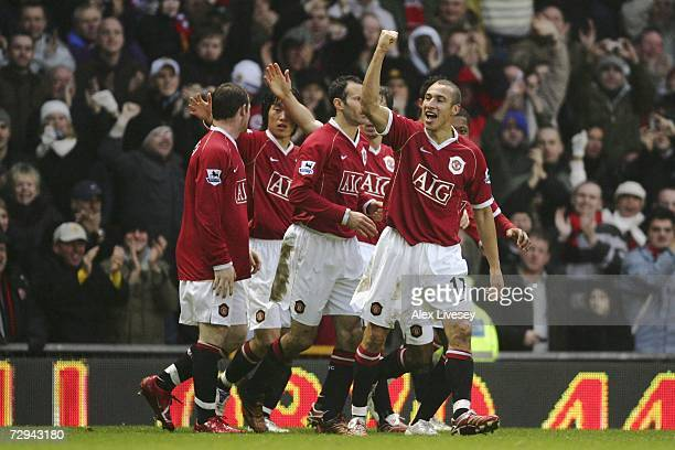 Henrik Larsson of Manchester United celebrates with his new team mates after scoring the opening goal on his debut during the FA Cup sponsored by EON...