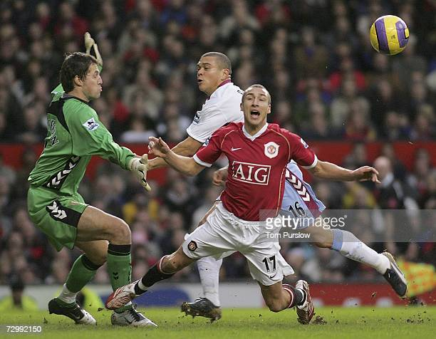 Henrik Larsson of Manchester United clashes with Wilfred Bouma of Aston Villa during the Barclays Premiership match between Manchester United and...