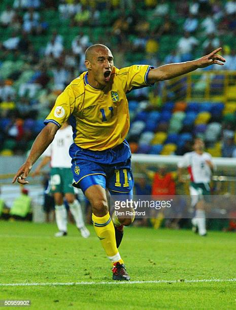 Henrik Larsson of Sweden celebrates scoring his first and Sweden's second goal during the UEFA Euro 2004 Group C match between Sweden and Bulgaria at...