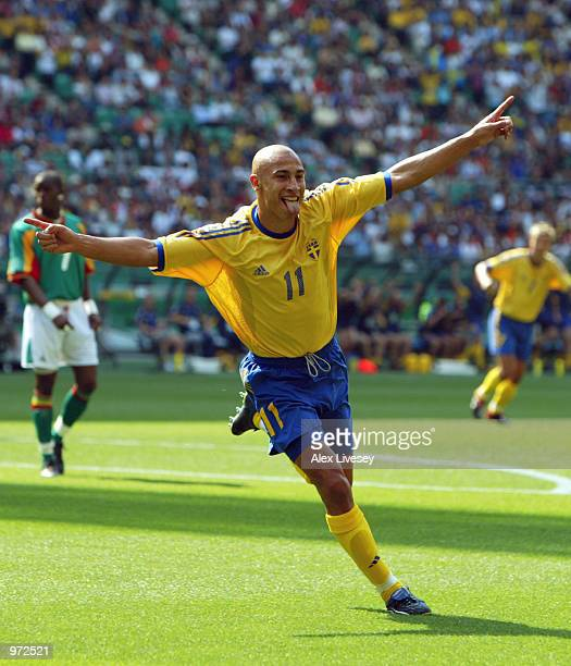 Henrik Larsson of Sweden celebrates scoring the first goal during the Sweden v Senagal World Cup Second Round match played at the Oita Big Eye...