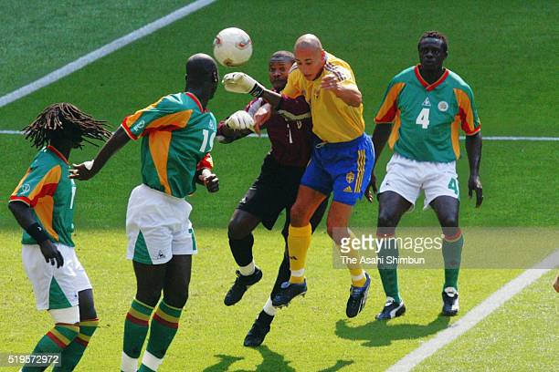 Henrik Larsson of Sweden heads the ball to score his team's first goal during the FIFA World Cup Korea/Japan Round of 16 match between Sweden and...