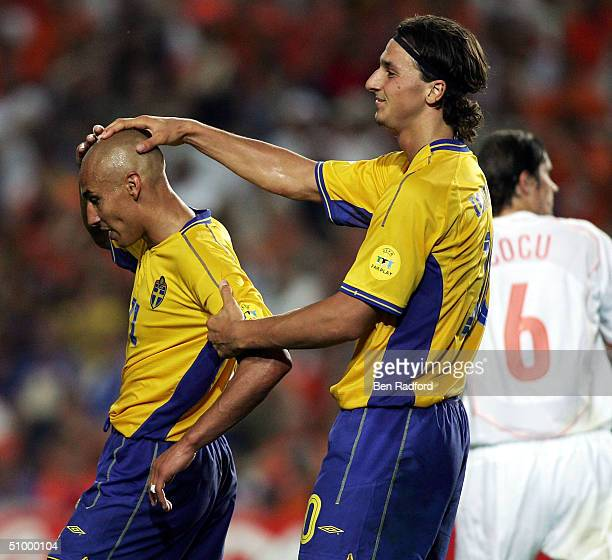 Henrik Larsson of Sweden is consoled by Zlatan Ibrahimovic after his shot hits the bar during the UEFA Euro 2004, Quarter Final match between Sweden...
