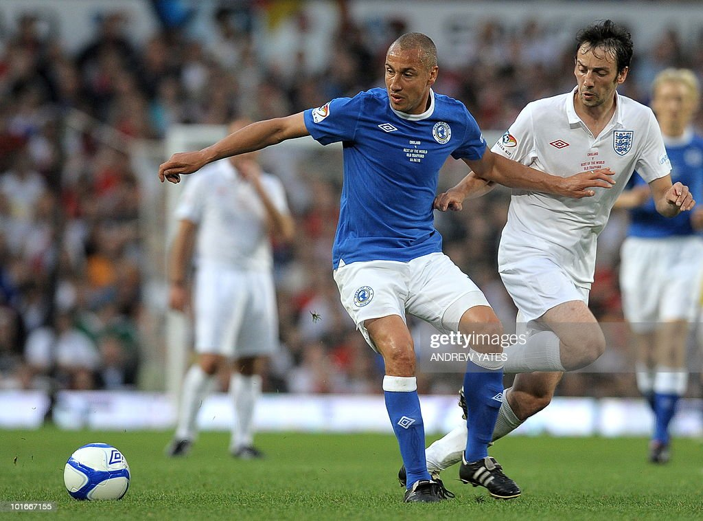 Henrik Larsson (L) of the Rest of the World vies with British actor Ralf Little during the Unicef Soccer Aid charity football match against the Rest of the world at Old Trafford in Manchester, north-west England on June 6, 2010. Soccer Aid is the brainchild of Robbie Williams and all money raised through profits from ticket sales and donations made by viewers of ITVduring the match will go to UNICEF�s invaluable work helping children around the world.