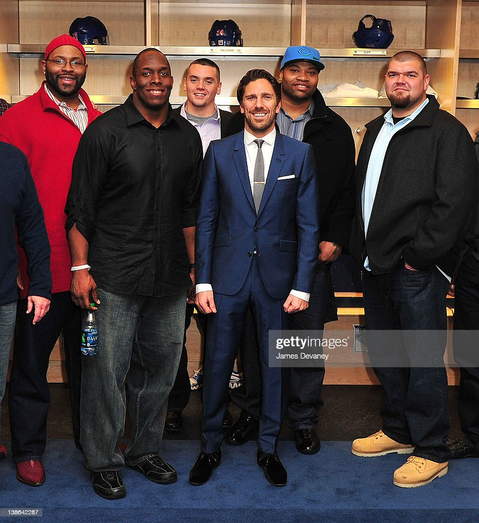 Henrik Linquist poses with New York Giants players in the Rangers locker room after the Tampa Bay Lightning vs the New York Rangers game at Madison Square Garden on February 9, 2012 in New York City.