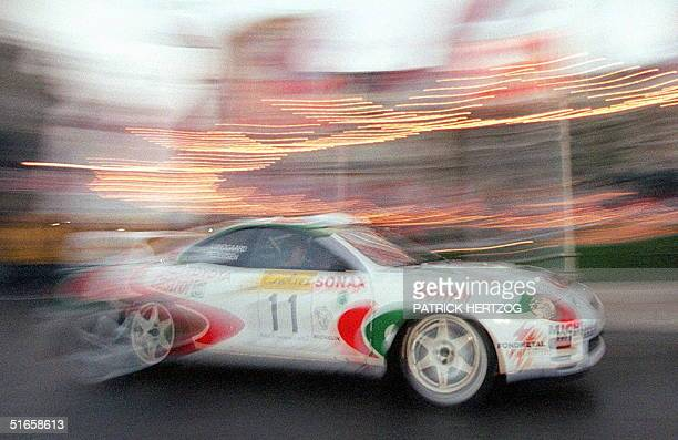 Henrik Lundgaard of Denmark and his teammate Freddy Pedersen on their Toyota Celica GT Four at the start of the 66th Monte Carlo Rally 19 January in...