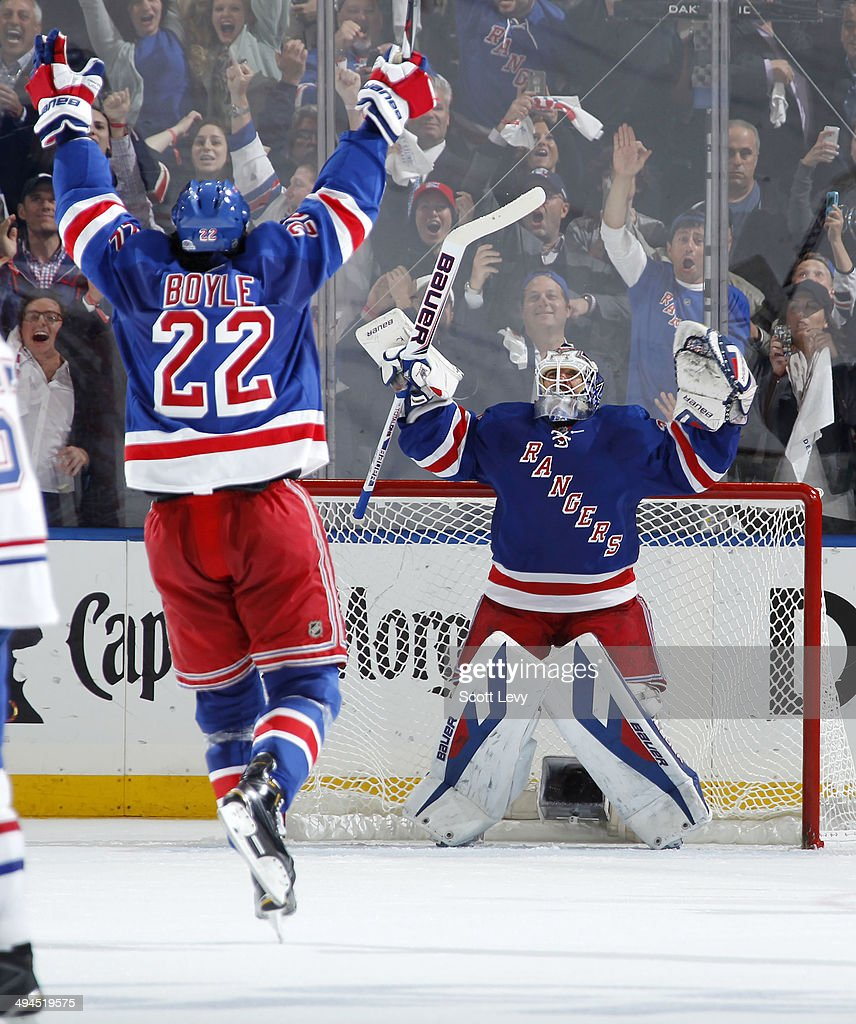 Henrik Lundqvist #30 and Brian Boyle #22 of the New York Rangers celebrate defeating the Montreal Canadiens 1-0 in Game Six of the Eastern Conference Final during the 2014 NHL Stanley Cup Playoffs at Madison Square Garden on May 29, 2014 in New York City.
