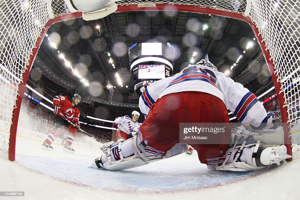 Henrik Lundqvist  30 and Brian Boyle  22 of the New York Rangers defend  against f64e7751a