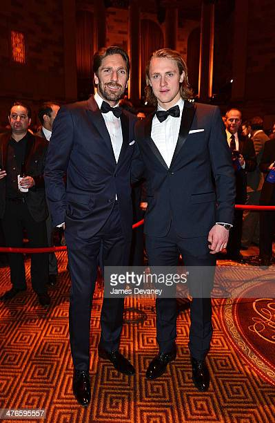 Henrik Lundqvist and Carl Hagelin attends the 2014 New York Rangers Casino Night To Benefit The Garden Of Dreams Foundation at Gotham Hall on March 3...