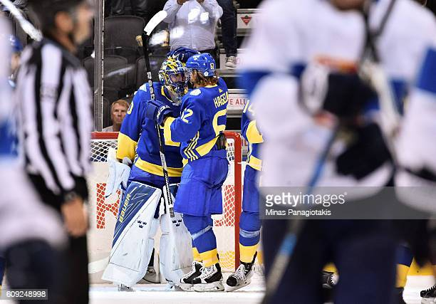 Henrik Lundqvist and Carl Hagelin of Team Sweden celebrate after a 20 win over Team Finland during the World Cup of Hockey 2016 at Air Canada Centre...