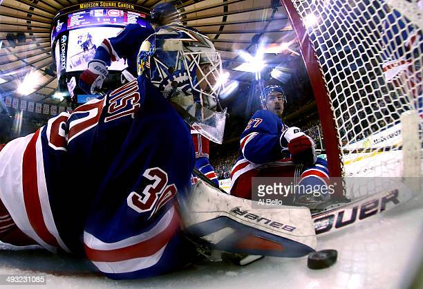 Henrik Lundqvist and Chris Kreider of the New York Rangers watches Daniel Briere of the Montreal Canadiens goal into the back of the net in Game...