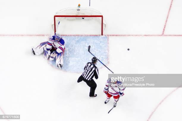 Henrik Lundqvist and Derek Stepan of the New York Rangers react after allowing the game tying goal by Derick Brassard of the Ottawa Senators in Game...