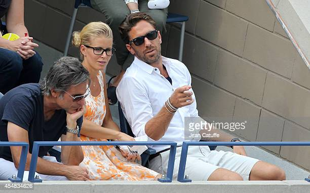 Henrik Lundqvist and his wife Therese Andersson attend the men's semi finals during Day 13 of the 2014 US Open at USTA Billie Jean King National...