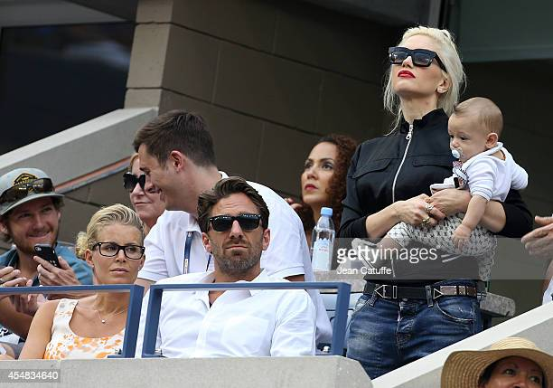 Henrik Lundqvist and his wife Therese Andersson Gwen Stefani and her son Apollo Rossdale attend the men's semi finals during Day 13 of the 2014 US...