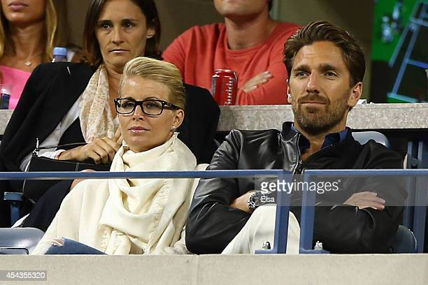 Henrik Lundqvist and his wife Therese Andersson watch Roger Federer of Switzerland play against Sam Groth of Australia during their men's singles...