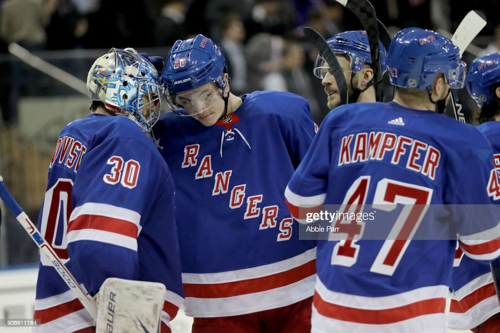 Henrik Lundqvist #30 and Jimmy Vesey #26 of the New York Rangers celebrate their 4-3 win against the Buffalo Sabres during their game at Madison Square Garden on January 18, 2018 in New York City.