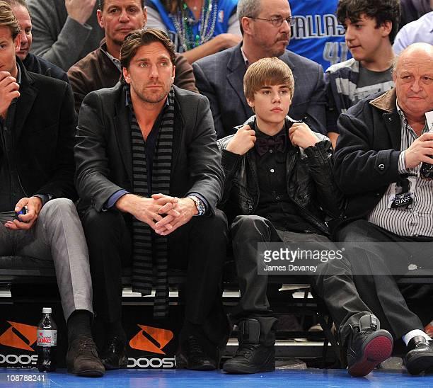 Henrik Lundqvist and Justin Bieber attend the Dallas Mavericks vs New York Knicks game at Madison Square Garden on February 2 2011 in New York City