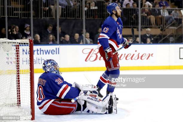 Henrik Lundqvist and Kevin Hayes of the New York Rangers react after a goal by Alexander Wennberg of the Columbus Blue Jackets in the first period...
