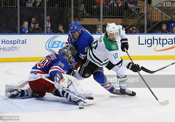 Henrik Lundqvist and Marc Staal of the New York Rangers combine to stop Patrick Sharp of the Dallas Stars during the third period at Madison Square...