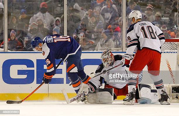 Henrik Lundqvist and Marc Staal of the New York Rangers in action against Peter Regin of the New York Islanders during the 2014 Coors Light NHL...
