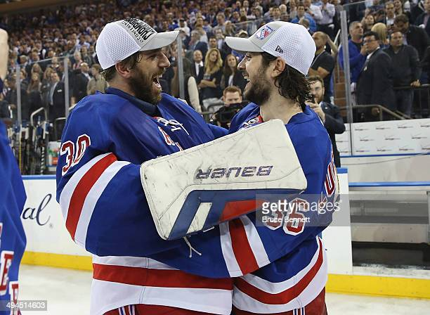Henrik Lundqvist and Mats Zuccarello of the New York Rangers celebrates after defeating the Montreal Canadiens in Game Six to win the Eastern...