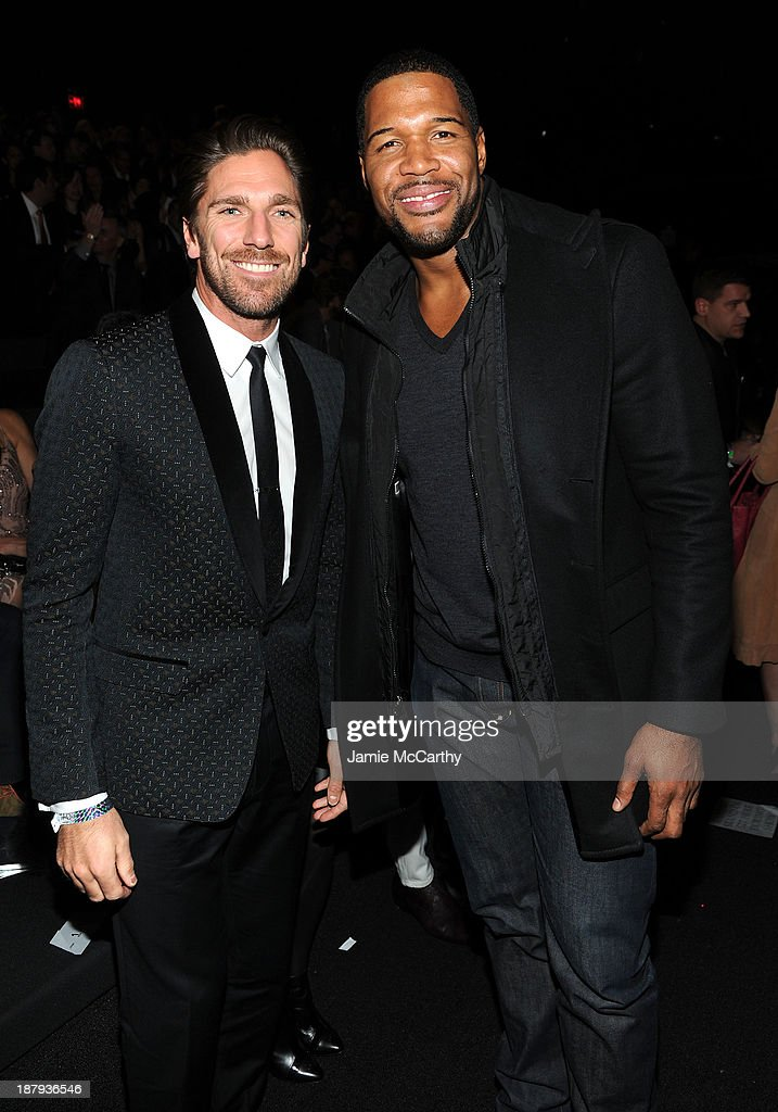 Henrik Lundqvist and Michael Strahan attend the 2013 Victoria's Secret Fashion Show at Lexington Avenue Armory on November 13, 2013 in New York City.