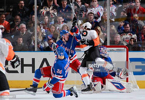 Henrik Lundqvist and Ryan McDonagh of the New York Rangers protect the net against Wayne Simmonds of the Philadelphia Flyers at Madison Square Garden...