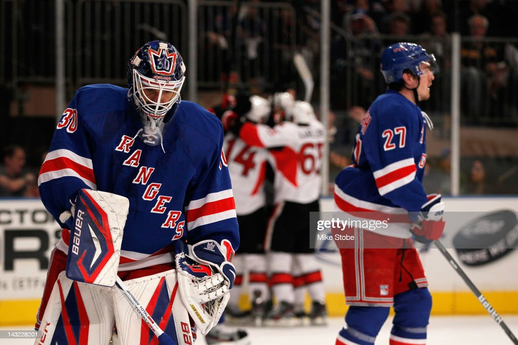 Henrik Lundqvist #30 and Ryan McDonagh #27 of the New York Rangers react as the Ottawa Senators celebrate after Jason Spezza #19 scored a goal in the first period of Game Five of the Eastern Conference Quarterfinals during the 2012 NHL Stanley Cup Playoffs at Madison Square Garden on April 21, 2012 in New York City.