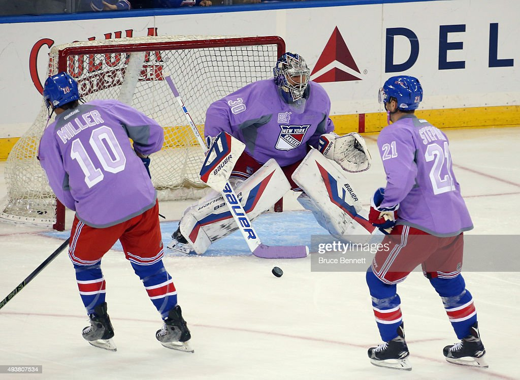 Henrik Lundqvist #30 and the New York Rangers wear special jerseys  commemmorating Hockey Fights Cancer