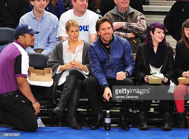 Henrik Lundqvist and Therese Andersson attend the Boston Celtics vs the New York Knicks game at Madison Square Garden on December 25 2011 in New York...