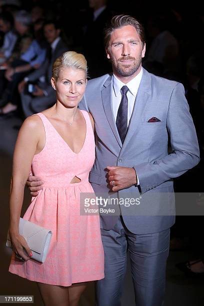 Henrik Lundqvist and Therese Andersson attend the Calvin Klein Collection show during Milan Menswear Fashion Week Spring Summer 2014 on June 23 2013...