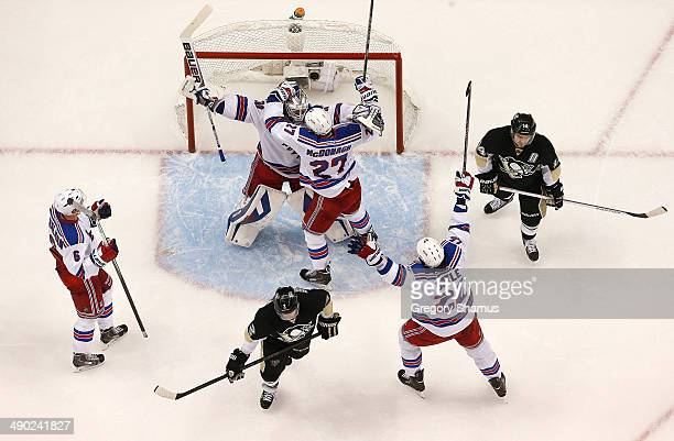 Henrik Lundqvist celebrates with Ryan McDonagh, Anton Stralman and Brian Boyle of the New York Rangers after beating the Pittsburgh Penguins 2-1in...