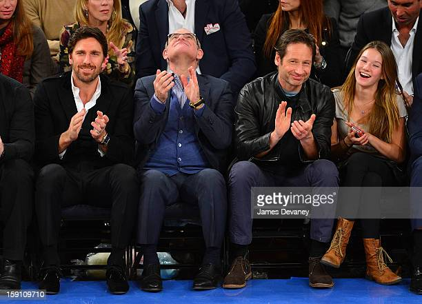 Henrik Lundqvist guest David Duchovny and Madelaine Duchovny attend the Boston Celtics vs New York Knicks game at Madison Square Garden on January 7...