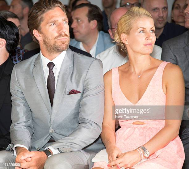 Henrik Lundqvist left and Therese Andersson attend the Calvin Klein Collection show during Milan Menswear Fashion Week Spring Summer 2014 on June 23...
