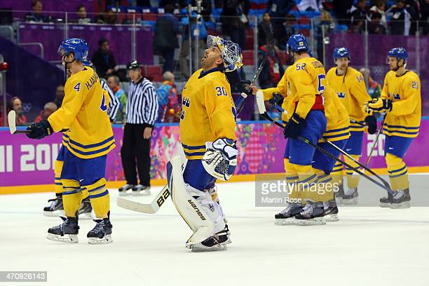 Henrik Lundqvist of Sweden and teammates celebrate winning the game against Finland 21 during the Men's Ice Hockey Semifinal Playoff on Day 14 of the...