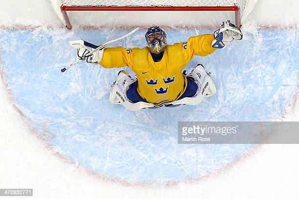 Henrik Lundqvist of Sweden celebrates after defeating Finland 21 during the Men's Ice Hockey Semifinal Playoff on Day 14 of the 2014 Sochi Winter...