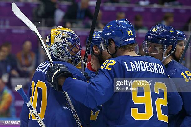 Henrik Lundqvist of Sweden celebrates with his teammate Gabriel Landeskog after defeating the Czech Republic 4 to 2 in the Men's Ice Hockey...