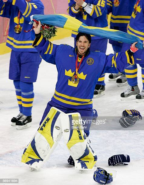 Henrik Lundqvist of Sweden waves the Swedish flag after Sweden defeated Finland 32 to win the gold medal during the final of the men's ice hockey...