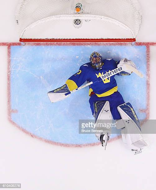Henrik Lundqvist of Team Sweden hits the ice after giving up a goal to Tomas Tatar of Team Europe at 12 seconds of the third period at the semifinal...
