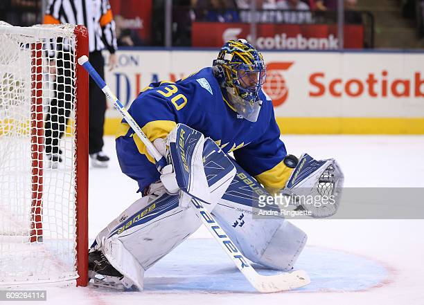 Henrik Lundqvist of Team Sweden makes a save off a shot from Team Finland during the World Cup of Hockey 2016 at Air Canada Centre on September 20...
