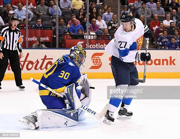 Henrik Lundqvist of Team Sweden makes a save with Joonas Donskoi of Team Finland creating traffic in front during the World Cup of Hockey 2016 at Air...