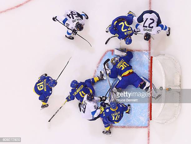 Henrik Lundqvist of Team Sweden makes the save in a crowd against Team Finland during the World Cup of Hockey tournament at the Air Canada Centre on...