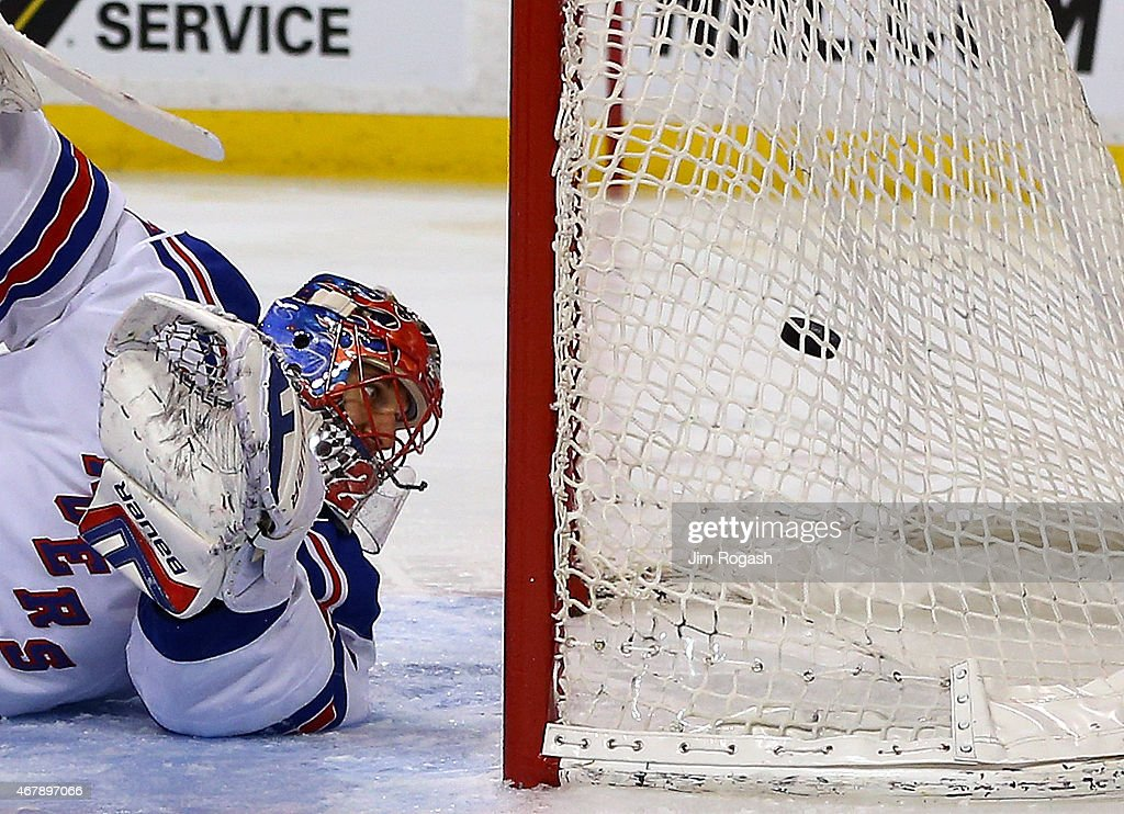 Henrik Lundqvist #30 of the New York Rangers allows a goal by Milan Lucic #17 of the Boston Bruins in the first period at the TD Garden on March 28, 2015 in Boston, Massachusetts.