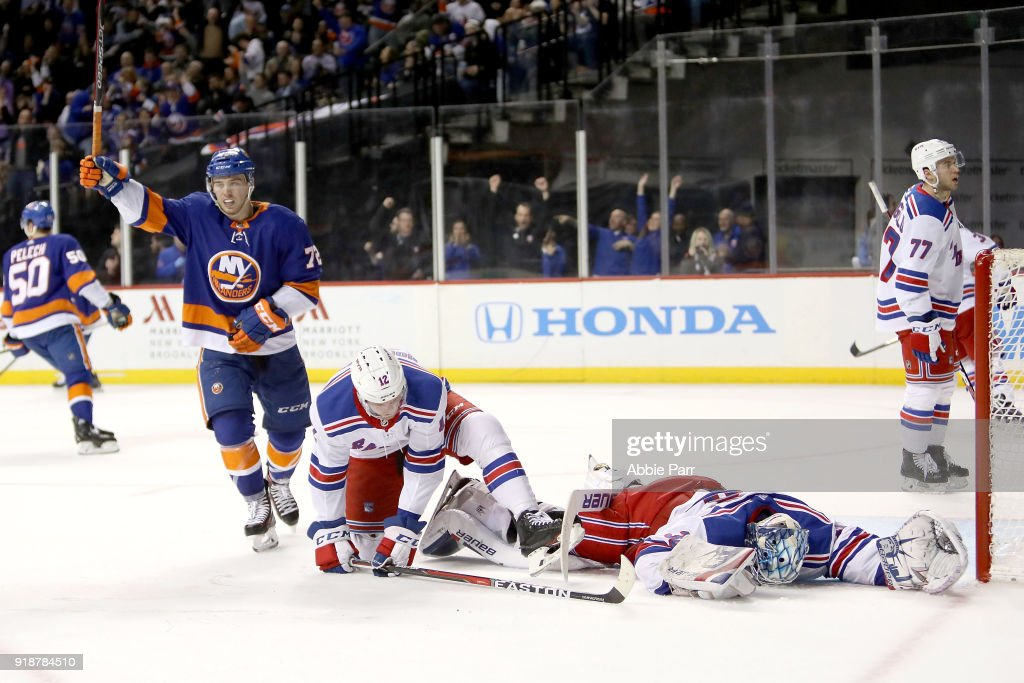 Henrik Lundqvist #30 of the New York Rangers and Anthony Beauvillier #72 of the New York Islanders react to a goal by Jordan Eberle #7 of the New York Islanders in the second period during their game at Barclays Center on February 15, 2018 in the Brooklyn borough of New York City.