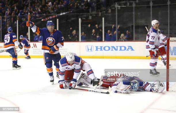 Henrik Lundqvist of the New York Rangers and Anthony Beauvillier of the New York Islanders react to a goal by Jordan Eberle of the New York Islanders...