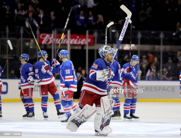 Henrik Lundqvist of the New York Rangers and the rest of his teammates celebrate the 21 win over the Vancouver Canucks at Madison Square Garden on...