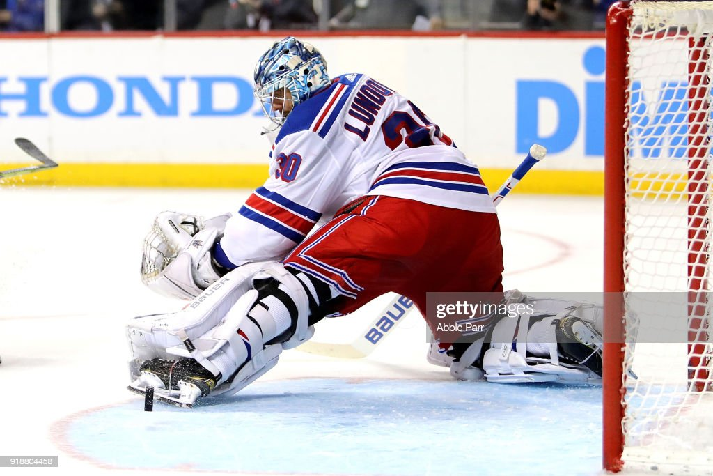 Henrik Lundqvist #30 of the New York Rangers blocks a shot against the New York Islanders in the second period during their game at Barclays Center on February 15, 2018 in the Brooklyn borough of New York City.