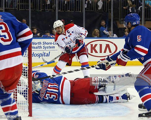 Henrik Lundqvist of the New York Rangers blocks a shot by Alex Ovechkin of the Washington Capitals during the first period in Game Two of the Eastern...