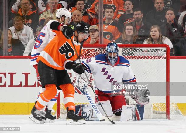 Henrik Lundqvist of the New York Rangers blocks the net during the first period against Michael Raffl of the Philadelphia Flyers at the Wells Fargo...