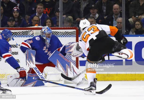 Henrik Lundqvist of the New York Rangers braces for a second period shot from Shayne Gostisbehere of the Philadelphia Flyers at Madison Square Garden...